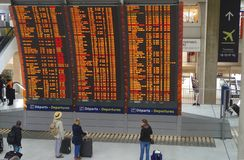 Massive information panel located in a train station. It provides timetable for all trains. royalty free stock photo