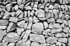Massive large wall composed of big stones Royalty Free Stock Images
