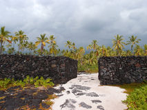 Massive man-made Rock Walls of Pu'uhonua o Honaunau - Place of R Royalty Free Stock Images