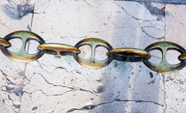 Massive metal chain on sidewalk in Madrid Royalty Free Stock Image