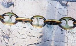 Massive metal chain on sidewalk in Madrid Royalty Free Stock Image