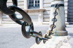Massive metal chain on sidewalk in Madrid Royalty Free Stock Photo