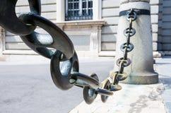 Massive metal chain on sidewalk in Madrid Royalty Free Stock Photo
