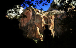Massive Mountains in Zion National Park. A silhouetted visitor marvels at the scale and beauty of a mountain in Zion National Park Royalty Free Stock Photos