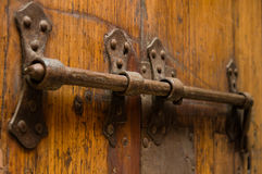 Massive old rusty iron lock on wooden door Royalty Free Stock Images