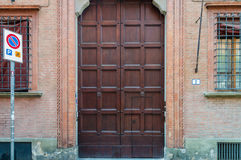 Massive. A massive old wooden door, Italy architecture Stock Photos