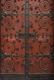 Massive ornate door. Elaborate metalwork on massive wooden door Royalty Free Stock Photo