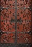 Massive ornate door. Elaborate metalwork on massive wooden door royalty free stock photo