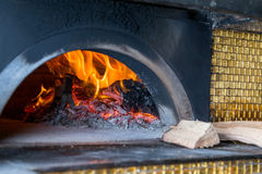 Massive oven for pizza on firewood Royalty Free Stock Photography