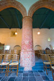 Massive pillar in an old church Royalty Free Stock Images