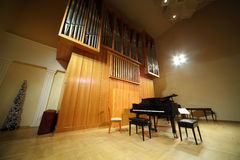 Massive pipe organ and concert grand piano Royalty Free Stock Image