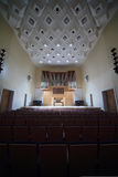 Massive pipe organ in empty concert hall Royalty Free Stock Images
