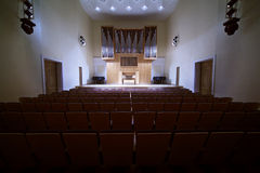 Massive pipe organ in empty concert hall Stock Photos