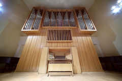 Massive pipe organ with metal tubes Stock Photo