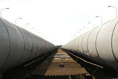 Massive pipes running parallel Royalty Free Stock Photos