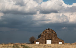 Massive Rock Barn. Huge old rock barn under a stormy sky stock images