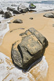 Massive rock on the beach op tropical Sanya Island, China Royalty Free Stock Photography