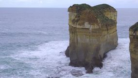 Massive rock formation at Loch Ard Gorge. Australia stock footage