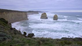 Massive rock formations stand along Great Ocean Road. Australia stock footage