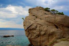 Massive rock at sea shore Stock Photo
