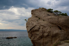 Massive rock at sea shore Royalty Free Stock Photo