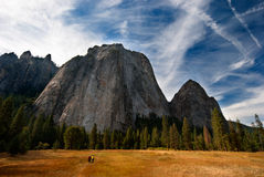 Massive rocks. Making the 2 people in the foreground look very small. Yosemite National Park Stock Image