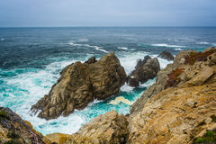 Massive rocks in the Pacific Ocean  Stock Images