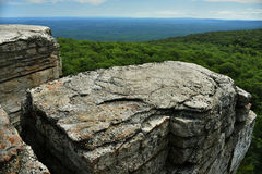 Massive rocks and view to the valley at Minnewaska State Park Royalty Free Stock Images