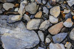 Massive shards of rocks on the shore royalty free stock images