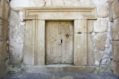 Massive stone door Royalty Free Stock Images