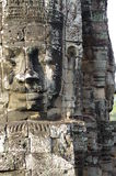 Massive stone faces of Prasat Bayon Royalty Free Stock Photo