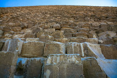 Massive stones of the Great Pyramid of Giza. This is a photograph from the ground looking up at the massive stones that make up the Great Pyramid of Giza, Cairo Stock Photo