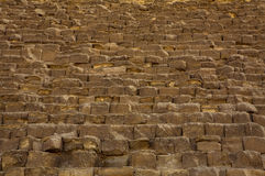 Massive stones of the Great Pyramid of Giza. This is a photograph of some of the massive stones that make up the Great Pyramid of Giza, Cairo, Egypt. One of the Stock Photography