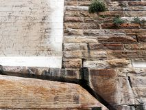 Sydney Sandstone Cliff and Retaining Wall, Australia. A massive Sydney sandstone cliff or retaining wall with sections of roughly shaped sandstone and smooth royalty free stock photos