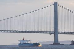 Massive Tanker under Nye York Bridge. Telephoto shot Royalty Free Stock Image