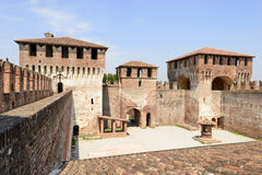 Massive towers in main courtyard, Soncino Castle. View of the massive towers that close the north side of main inner court in the ancient Sforzesco Castle, shot royalty free stock photography