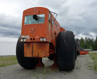 A massive tractor on display in the yukon territories Stock Photo