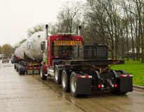 A massive trailer carrying a l large, heavy part at a rest area in america. An over-sized load being hauled on the interstate on more than one hundred tires Stock Images