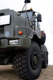 Massive truck. Very large military truck, isolated from ground up royalty free stock images