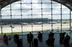 Massive waiting room with beautiful view on planes connected to terminal F in Charles de Gaulle airport. stock photos