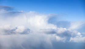 Massive white cumulus clouds in blue sky Royalty Free Stock Image