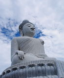 Massive white marble Buddha statue and tourist destination on top of hill in Phuket, Thailand. Royalty Free Stock Photography