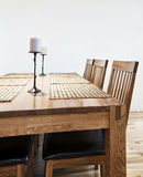 Massive wood dining table. Six seat massive wood dining table with chairs Stock Images