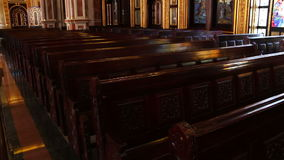 Massive wooden benches in church stock video footage