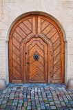 Massive wooden door. Image is taken in Prague stock photography