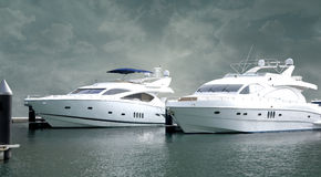 Massive Yachts. Two massive yachts on the dubai marina dock yard. Image with Clipping path Stock Photos