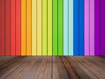 Massivholzboden und bunte Wand Lizenzfreie Stockfotografie