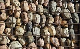 Massor av stenar i en bur Royaltyfria Bilder