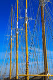 Mast against blue summer sky. Yacht mast against blue summer sky Royalty Free Stock Images