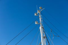 Mast of big white ship moored in port. Port in Jastarnia, Poland Stock Images